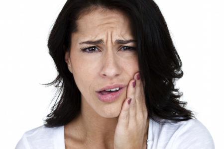 Головная боль после удаления зуба: профилактика и лечение