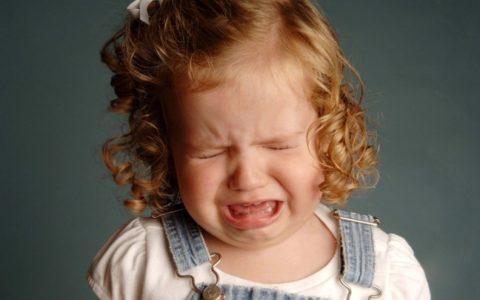 Почему болит голова после плача